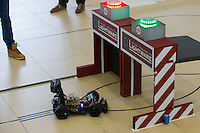 Robotic car tries to cross an obstacle during the RobonAut technical university race for self driving autonomous cars in Budapest, Hungary on January 10, 2015. ATTILA VOLGYI