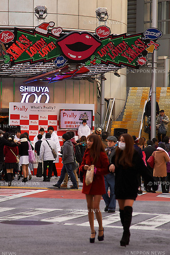 People go to shopping at Shibuya area during the Lower House election's day on December 14, 2014. The Japan's general election has started throughout the country with more than 48,000 polling stations opened on Sunday from 7am to 8pm. In this election 1191 candidates are vying for 475 seats. The voter turnout could hit record lows. (Photo by Rodrigo Reyes Marin/AFLO)