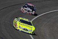Oct. 10, 2009; Fontana, CA, USA; NASCAR Nationwide Series driver Paul Menard leads Trevor Bayne during the Copart 300 at Auto Club Speedway. Mandatory Credit: Mark J. Rebilas-