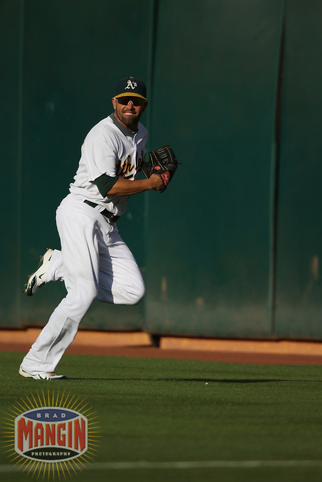 OAKLAND, CA - JULY 30:  David DeJesus #12 of the Oakland Athletics plays defense in right field against the Minnesota Twins during the game at the Oakland-Alameda County Coliseum on July 30, 2011 in Oakland, California. Photo by Brad Mangin