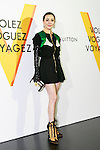 Hong Kong actress Carina Lau poses for the cameras during the opening celebration for Louis Vuitton's ''Volez, Voguez, Voyagez'' exhibition on April 21, 2016, Tokyo, Japan. After a successful run in Paris, the luxury fashion brand now brings the instalment to Tokyo, which traces Louis Vuitton's history from 1854 to today. Some 1,000 objects, including rare trunks, photographs and handwritten client cards will be displayed. Japanese room will be set up specially for Japan, showcasing such rare items as makeup and tea ceremony trunks for kabuki actor Ebizo XI. The exhibition will be open to the public free of charge from April 23 to June 19. (Photo by Rodrigo Reyes Marin/AFLO)