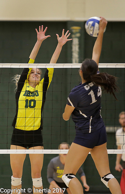 SPEARFISH, SD: SEPTEMBER 29:  Janice Jin #14 of Colorado Mines hits toward Ellise Lech #10 of Black Hills State during their college volleyball match Friday at the Donald E. Young Center in Spearfish, S.D.   (Photo by Dick Carlson/Inertia)