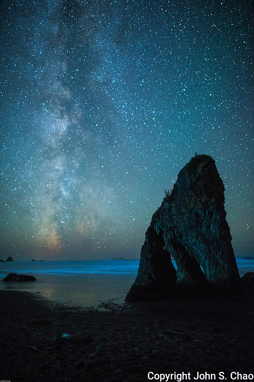 Milky Way passes by sea stack silhouetted on Ruby Beach, Olympic National Park, Washington State.