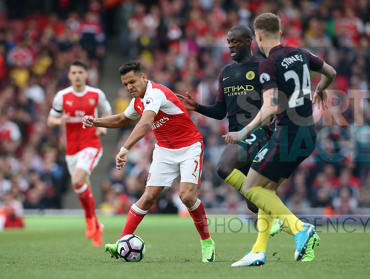 Arsenal's Alexis Sanchez tussles with Manchester City's Yaya Toure during the Premier League match at the Emirates Stadium, London. Picture date: April 2nd, 2017. Pic credit should read: David Klein/Sportimage