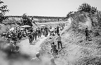 Breakaway group on the 2nd cobble section (#14) of the stage. <br /> <br /> Stage 9: Arras Citadelle > Roubaix (154km)<br /> <br /> 105th Tour de France 2018<br /> ©kramon