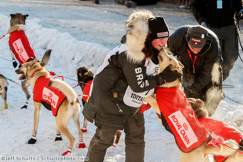 Laura Neese gives her dogs a pet and hug just prior to leaving the Ceremonial Start of the 2017 Iditarod in Anchorage on Saturday March 4, 2017 <br /> <br /> Photo by Jeff Schultz/SchultzPhoto.com  (C) 2017  ALL RIGHTS RESVERVED