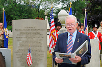 Richard Mason, Fellow of the Company of Military Historians, reads the address on founding father Roger Sherman, signer of Declaration of Independence and Constitution, first mayor of New Haven and Senator, at his grave site during a July Fourth ceremony to also recognize fallen patriots of the Revolutionary War, Grove Street Cemetery, New Haven, Connecticut, USA.