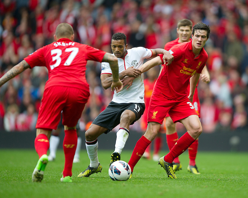 Manchester United's Nani battles with Liverpool's Martin Skrtel (L) and Martin Kelly ..Football - Barclays Premiership - Liverpool v Manchester United - Sunday 23rd September 2012 - Anfield - Liverpool..