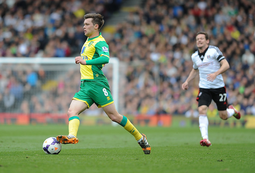Norwich City's Jonathan Howson pursued by Fulham's Sascha Riether<br /> <br /> Photo by Ashley Western/CameraSport<br /> <br /> Football - Barclays Premiership - Fulham v Norwich City - Saturday 12th April 2014 - Craven Cottage - London<br /> <br /> &copy; CameraSport - 43 Linden Ave. Countesthorpe. Leicester. England. LE8 5PG - Tel: +44 (0) 116 277 4147 - admin@camerasport.com - www.camerasport.com