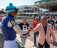 OLDSMAR, FL - JANUARY 21: Edwin Gonzalez, celebrating his win with a fan, after winning the 4yr olds and up claiming race, on Skyway Festival Day at Tampa Bay Downs on January 21, 2017 in Oldsmar, Florida. (Photo by Douglas DeFelice/Eclipse Sportswire/Getty Images)
