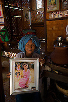 Daw Aye Than a 65 year old women with a photo of her 24 year old daughter from the traditional Minnanthu Village near Bagan, Myanmar/Burma