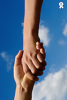 Two children (9-13) holding hands, close-up (Licence this image exclusively with Getty: http://www.gettyimages.com/detail/200472110-001 )