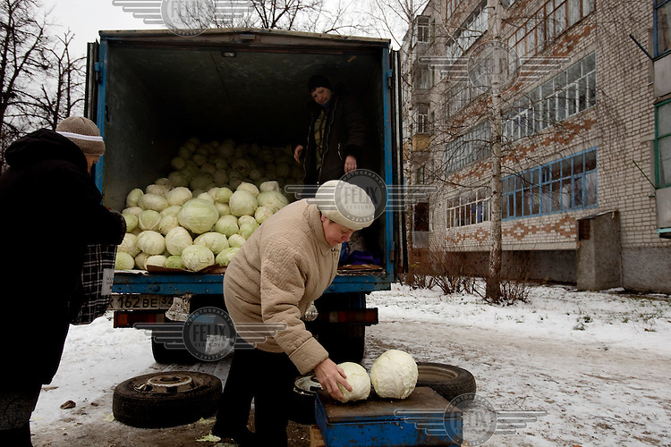 A woman buys cabbage from a hawker in a truck in Ludinovo, near the city of Kaluga southwest of Moscow. .Picture by Justin Jin.