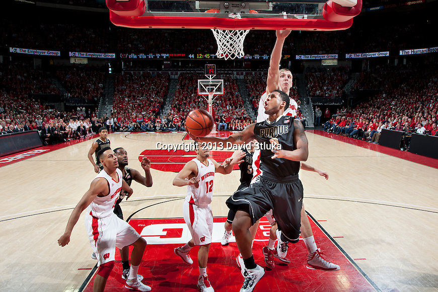 Purdue Boilermakers guard Terone Johnson (0) shoots a reverse layup during a Big Ten Conference NCAA college basketball game against the Wisconsin Badgers Sunday, March 3, 2013, in Madison, Wis. Purdue won 69-56. (Photo by David Stluka)