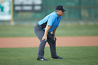 Umpire Brian Sain handles the calls on the bases during the Southern Collegiate Baseball League game between the Carolina Venom and the Mooresville Spinners at Moor Park on June 22, 2020 in Mooresville, NC.  The Spinners defeated the Venom 7-2. (Brian Westerholt/Four Seam Images)