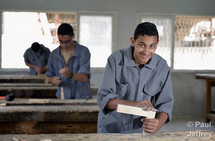 Mahmoud Abu-Ata sands a wood joint in a woodworking class in the Vocational Training Center in Gaza City, Gaza. The center is run by the Department of Service for Palestinian Refugees of the Near East Council of Churches, a member of the ACT Alliance, and funded in part by the Pontifical Mission for Palestine.