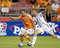 Houston Dynamo midfielder Brian Mullan (9) attempts to shield the ball from Real Salt Lake defender Chris Wingert (17). The Houston Dynamo defeated Real Salt Lake 4-3 during an MLS regular season game at Robertson Stadium in Houston, TX on September 8, 2007.