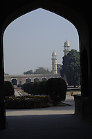The view through the one of the arches of the entrance gate to two of the four towers of Emperor Jahangir's Tomb in Lahore.