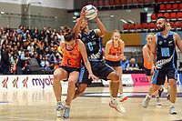 NZ Men's Kruze Tangira collides with All Stars Claire Kersten during the Cadbury Netball Series match between NZ Men and All Stars at the Bruce Pullman Arena in Papakura, New Zealand on Friday, 28 June 2019. Photo: Dave Lintott / lintottphoto.co.nz