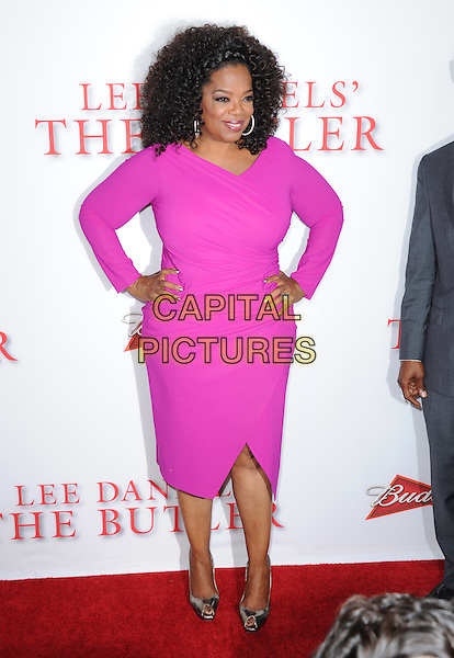 Oprah Winfrey<br /> &quot;Lee Daniels' The Butler&quot; Los Angeles Premiere held at Regal Cinemas L.A. Live, Los Angeles, California, USA.        <br /> August 12th, 2013    <br /> full length dress hands on hips pink <br /> CAP/DVS<br /> &copy;DVS/Capital Pictures