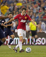 Manchester United FC defender Jonathan Evans (23) passes the ball. In a Herbalife World Football Challenge 2011 friendly match, Manchester United FC defeated the New England Revolution, 4-1, at Gillette Stadium on July 13, 2011.