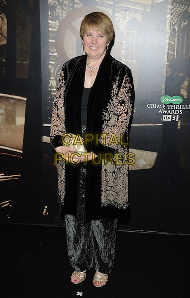 DIANE JANES .At the Specsavers Crime Thriller Awards 2010, Grosvenor House Hotel,  Park Lane, London, England, UK, .8th October 2010..full length black patterned velvet coat trousers gold clutch bag .CAP/CAN.©Can Nguyen/Capital Pictures.