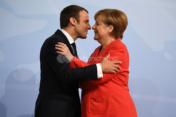 German chancellor Angela Merkel greets the French president Emmanuel Macron at the G20 summit in Hamburg, Germany, 7 July 2017. The heads of the governments of the G20 group of countries are meeting in Hamburg on the 7-8 July 2017. Photo: Michael Kappeler/dpa /MediaPunch ***FOR USA ONLY***