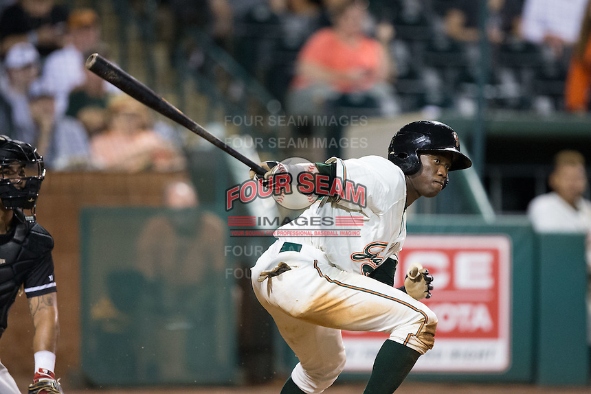 Anfernee Seymour (12) of the Greensboro Grasshoppers follows through on his swing against the Kannapolis Intimidators at NewBridge Bank Park on July 7, 2016 in Greensboro, North Carolina.  The Dash defeated the Pelicans 13-9.  (Brian Westerholt/Four Seam Images)