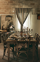 A table set for breakfast in the dining room of the Locanda di Villa Toscana in the village of Bibbona