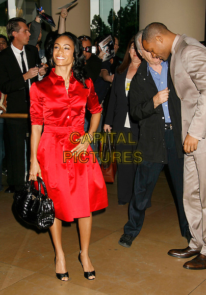 JADA PINKETT SMITH & WILL SMITH.79th Annual Academy Awards Nominees Luncheon held at the Beverly Hilton Hotel, Beverly Hills, California, USA,.05 February 2007..full length red shirt dress gold hoop earrings married husband wife couple black bag Christian Louboutin shoes looking down funny.CAP/ADM/RE.©Russ Elliot/AdMedia/Capital Pictures.