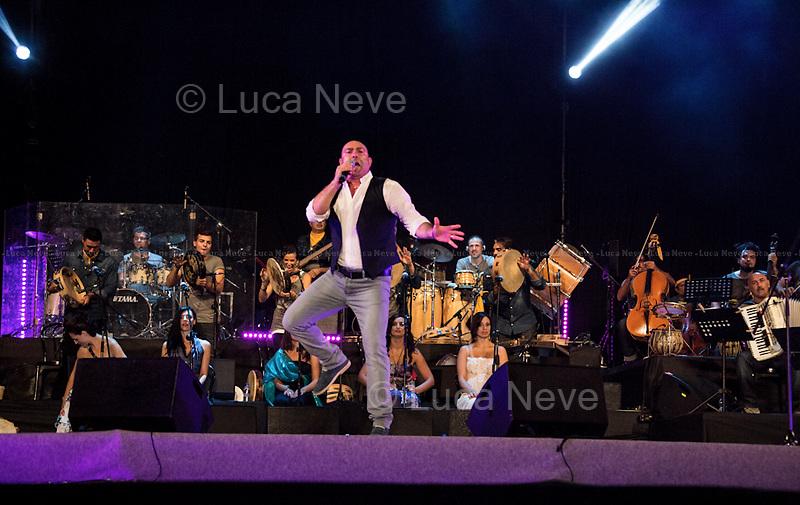 Melpignano (Salento, Puglia - Italy), 24/08/2013. XVI Edition of the International Music Festival &quot;La Notte della Taranta&quot;. The festival, held in the southern Italian region of Apulia, is an important part of the Pizzica folk music tradition (instruments: traditionally violins, mandolins, guitar, flute, accordion and large tambourine) celebrated with both music and dance. The Pizzica is a popular Italian folk dance, originally from the Salento peninsula - in Apulia region - and later spreading throughout all the Puglia and Calabria regions and eastern Basilicata. It is part of the larger family of tarantella dances. Musicians and dancers from everywhere in the world every year come to play in front of hundreds of thousands people in the town of Melpignano for the grand finale called the &quot;Concertone. <br /> <br /> Orchestra Popolare &quot;La Notte della Taranta&quot;:<br /> Directed by Maestro Concertatore Giovanni Sollima<br /> Musical Assistant: Claudio Prima<br /> Antonio Amato, Alessandra Caiulo, Ninfa Giannuzzi, Stefania Morciano, Enza Pagliara, Alessia Tondo, Anna Cinzia Villani (Vocals)<br /> Piero Balsamo, Vito De Lorenzi, Riccardo Lagan&agrave;, Martina Zecca, Edoardo D'Ambrosio Zimba (Tambourines)<br /> Claudio Prima (Accordion)<br /> Roberto Gemma (Piano accordions) <br /> Gianluca Longo (Mandola)<br /> Attilio Turrisi (Swing guitar)<br /> Massimiliano De Marco (Guitar)<br /> Silvio Maria Cantoro (Bass)<br /> Antonio Marra (Drums)<br /> Alessandro Monteduro (Percussions) <br /> Maristella Martella (Dance)  <br /> Piero Balsamo, Laura Boccadamo, Andrea Caracuta, Laura De Ronzo, Silvia Perrone, Lucia Scarabino (Coordinamento)<br /> With the participation of: Antonio Castrignan&ograve;, Mauro Durante, Emanuele Licci, Maria Mazzotta<br /> Special guests of the Orchestra: Venticello, Manuela Adamo, Jesus Bautista, Corrado Bungaro, Sara Calvanelli, Giancarlo Parisi, Andrea Senatore<br /> Sandro Cappelletto (Artistic Director)<br /> Sergio Torsello
