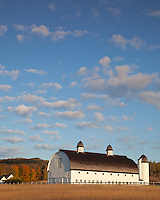 Sleeping Bear Dunes National Lakeshore, MI:  Morning clouds over the historic D. H. Day Farm and forested hills in fall near Glen Haven