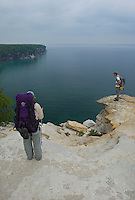 Backpackers look out over the cliffs of Pictured Rocks National Lakeshore near Munising, Michigan.
