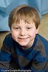 Education Elementary school Grade 2 closeup portrait of boy vertical