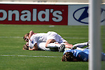 24 August 2003: Mia Hamm (top) and Abby Wambach (bottom celebrate, while Kyle Bivens (4) lays face down nearby, after Wambach scored the game winning goal. The Washington Freedom defeated the Atlanta Beat 2-1 in golden goal overtime to win the WUSA Founders Cup III championship game played at Torero Stadium in San Diego, CA.