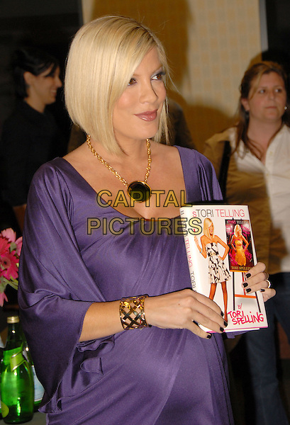 "TORI SPELLING.Signing her new book ""Tori Telling"" held at Barnes & Noble at The Grove at Farmers Market, Los Angeles, California, USA..half length purple silk satin dress pregnant gold bracelet black necklace .March 14th, 2008.CAP/ADM/MG.©Mario Garcia/AdMedia/Capital Pictures."