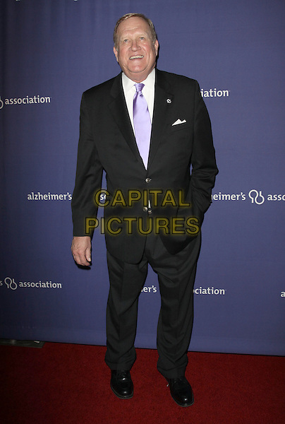 "KEN HOWARD.18Th Annual ""A Night at Sardi's"" Benefitting The Alzheimer's Association held At The Beverly Hilton Hotel, Beverly Hills, California, USA..March 18th, 2010.full length black  suit hand in pocket purple tie.CAP/ADM/KB.©Kevan Brooks/AdMedia/Capital Pictures."