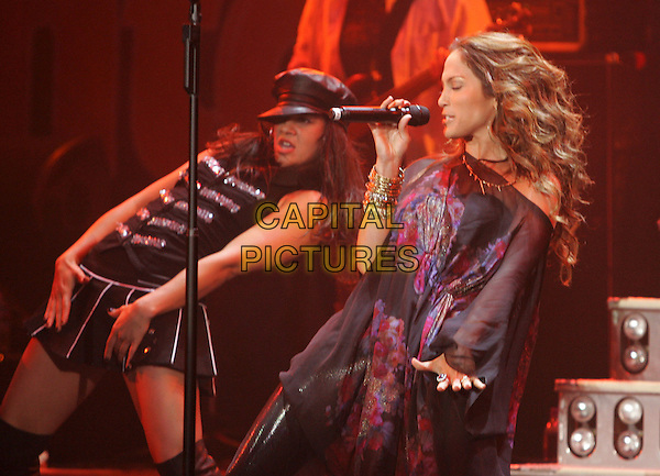 JENNIFER LOPEZ.Performs live to a sold out crowd at The Reventon Super Estrella held at The Verizon Wireless Ampitheatre in Irvine,  California, USA, June 02 2007..half length concert music gig on stage black patterned dress kaftan poncho bangles bracelets  performing microphone dancer dancing leaning back .CAP/DVS.©Debbie VanStory/Capital Pictures