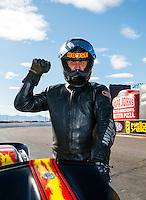 Feb 26, 2017; Chandler, AZ, USA; NHRA top fuel nitro Harley Davidson rider Rickey House celebrates after winning the Arizona Nationals at Wild Horse Pass Motorsports Park. Mandatory Credit: Mark J. Rebilas-USA TODAY Sports
