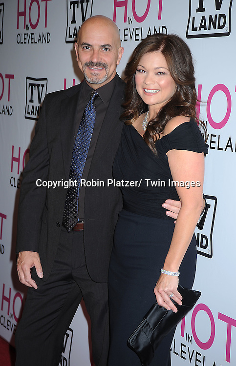 """Valerie Bertinelli and fiancee Tom Vitale  posing for photographers at The """"Hot In Cleveland"""" premiere party and screening on June 14, 2010 .at The Crosby Street Hotel in New York City."""