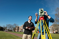 Surveying on Drill Field for Civil Engineering class assignment - student team: Joel Cummins (in black) and Josh Rainey (in blue). <br />  (photo by Megan Bean / &copy; Mississippi State University)
