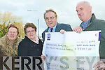 Generous: Having raised EUR15,000 through his Christmas lighting display in his Templeglantine home, Tony Noonan (far right) presented Noreen O'Keeffe and Mary B Hayes of the Adare Alzheimer's Society and Jim Doherty of the Milford Hospice with cheques on Thursday morning.