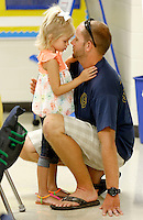 NWA Democrat-Gazette/DAVID GOTTSCHALK  Abree Vitali, a kindergarten student at Owl Creek School, says goodbye to her dad Chris in the class of Emily Foster during the first day of school at the  continuous learning school Tuesday, August 4, 2015 in Fayetteville. Schools on the traditional learning calendar will begin Monday, August 17.
