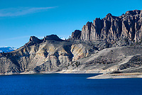 The Dillon Pinnacles rise above Blue Mesa Reservoir near Gunnison, Colorado. The rock which forms them was laid down by volcanic eruptions millions of years ago and then rain and wind sculpted the pinnacles to what we see today