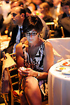 An attendee at the Holly's Angels gala benefit at Cipriani sends in a text donation to Making Headway Foundation to support cancer research.