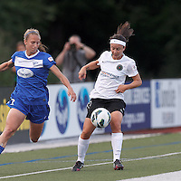 Portland Thorns FC substitute forward Tiffany Weimer (19) controls the ball as Boston Breakers defender Julie King (8) closes. In a National Women's Soccer League (NWSL) match, Boston Breakers (blue) defeated Portland Thorns FC (white/black), 2-1, at Dilboy Stadium on August 7, 2013.