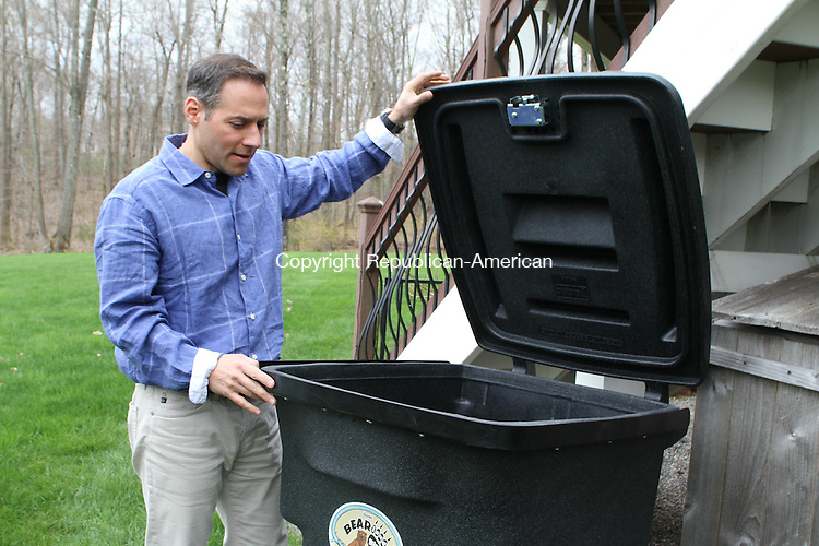 WATERTOWN, CT-07 May 2013-0507113LW01 - Kevin Lacilla, owner of BEARicuda, shows off his bear-proof garbage can outside his home in Watertown. Laraine Weschler Republican-American