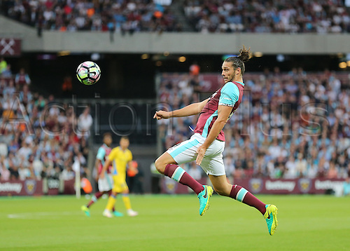 04.08.2016. Olympic Stadium, London, England. Europa League Football Qualifying 2nd Leg. West Ham versus NK Domzale. West Ham United Striker Andy Carroll heads the ball down to West Ham United Midfielder Cheikhou Kouyate who makes it 2-0 West Ham