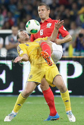 10.09.2013. Kiev, Ukraine.  Ukraine's Roman Zozulya (L) fights for the ball with England's Phil Jagielka (R) during the World Cup qualifying soccer match at the Olympic stadium in Kiev September 10, 2013.  The game ended in a 0-0 draw allowing England to go top of their group.