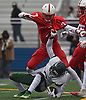 Jordan Clinton #6 of Floyd grabs the jersey of Arnold Cruz #7 of Freeport after being tackled in the Class I Long Island Championship at Shuart Stadium in Hempstead on Saturday, Nov. 24, 2018.